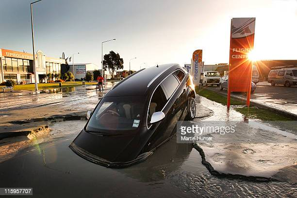 Car stands in water on Ferry Road after two magnitude 6.0 and 5.5 earthquakes struck on June 13, 2011 in Christchurch, New Zealand. The aftershocks...