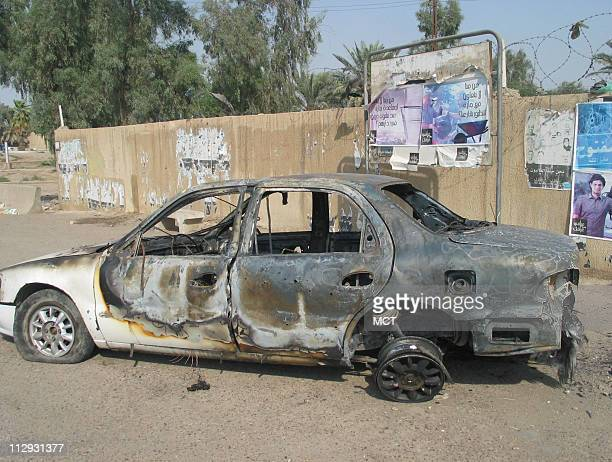 Car still at a traffic circle in central Baghdad where a shoot-out with private security company Blackwater left 9 Iraqis dead and 15 injured....