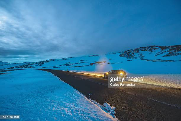 Car stopped on road in winter