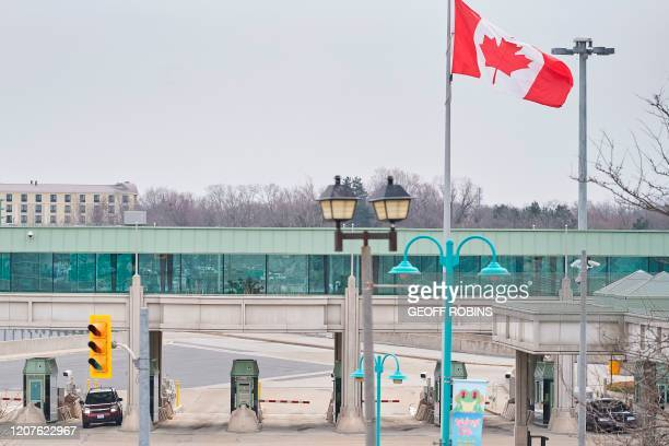 Car stops at a Canadian Customs booth in Niagara Falls, Ontario, on March 18 hours after Prime Minister Justin Trudeau announced the closing of the...
