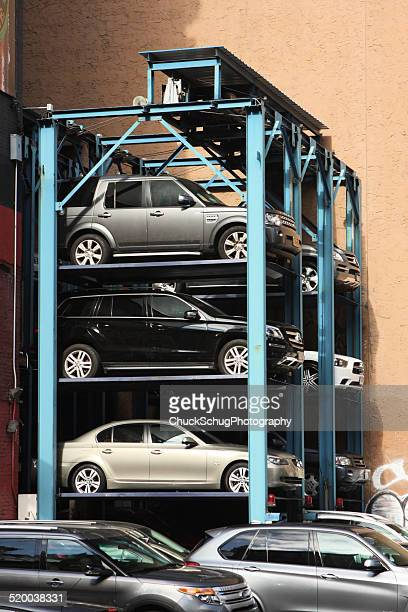 car storage hydraulic rack - parking valet stock photos and pictures