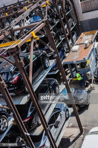 car storage - parking valet stock photos and pictures