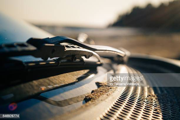 car strewn by sand, close up view