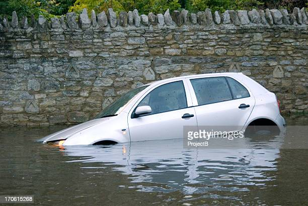 car stuck in rural flooding - sunken stock pictures, royalty-free photos & images
