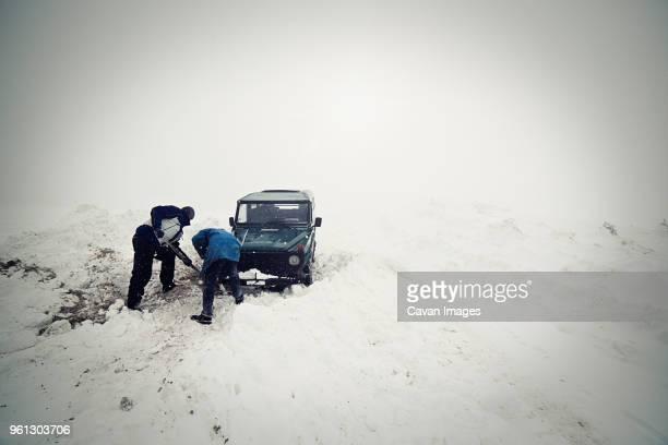 Car stuck in snow field