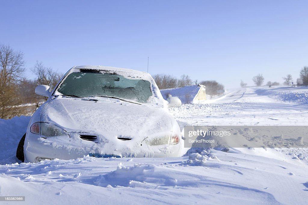 Car Stuck in Snow off an Interstate Highway : Stock Photo