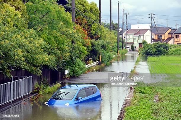 A car sunk on submerged road by torrential rain on August 14 2012 in Uji Kyoto Japan