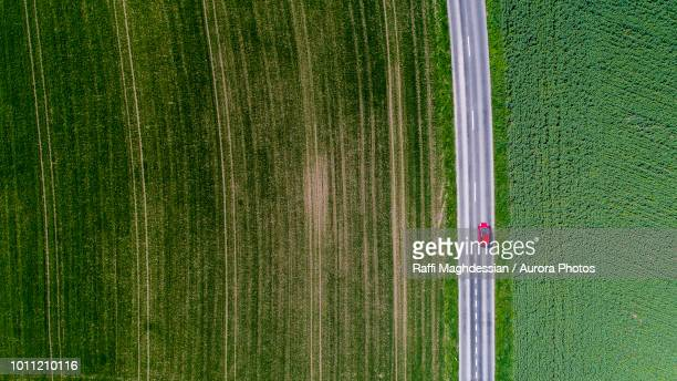 car surrounded by fields, genolier, vaud canton, switzerland - kanton waadt stock-fotos und bilder