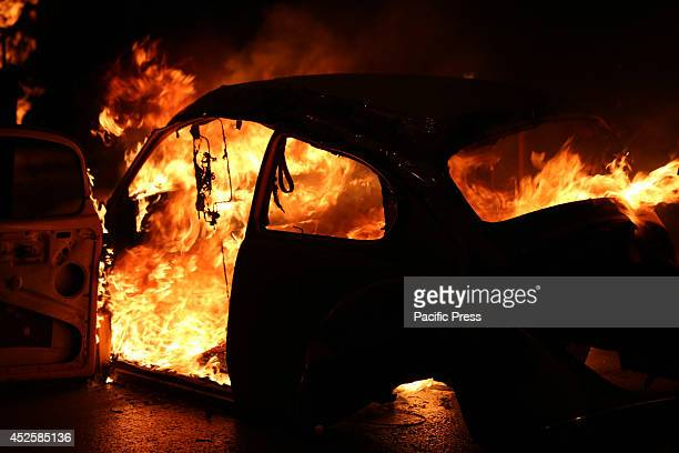 A car that has been set on fire and is used as a barricade against Israeli soldiers in the streets of Bethlehem Palestinians defiantly came out into...