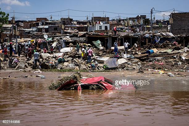 TOPSHOT A car that was washed away floats close to the banks of the Jukskei River in Alexandra Township after floodwaters ravaged the area destroying...