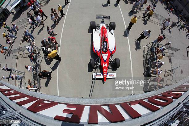 Car the ABC Supply Co AJ Foyt Racing Dallara Honda driven by Vitor Meira of Brazil leaves gasoline alley as it is towed toward pit lane during...