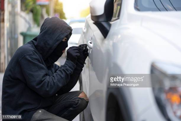 car theft : outlaws attacked stealing white cars using skeleton. key is a tamper tool. car 2017 - vandalism stock pictures, royalty-free photos & images