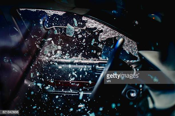 car thief breaking car window - thief stock pictures, royalty-free photos & images