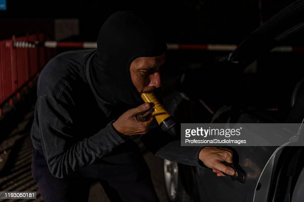 car thief during a night action - looting stock pictures, royalty-free photos & images