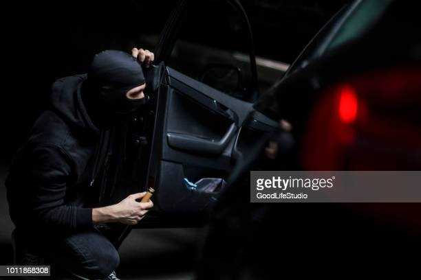 car thief - burglary stock pictures, royalty-free photos & images