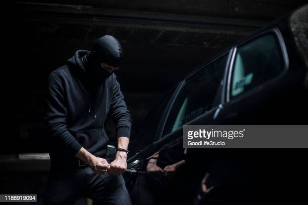 car thief - looting stock pictures, royalty-free photos & images