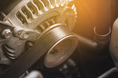 Car timing belt and alternator.