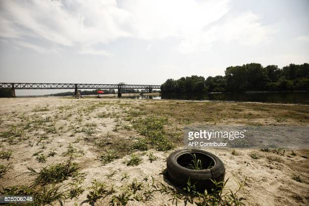 A car tire lies on a dry sandbank near the Po River near the Ponte della Becca bridge in Linarolo near Pavia northern Italy on August 1 as the...