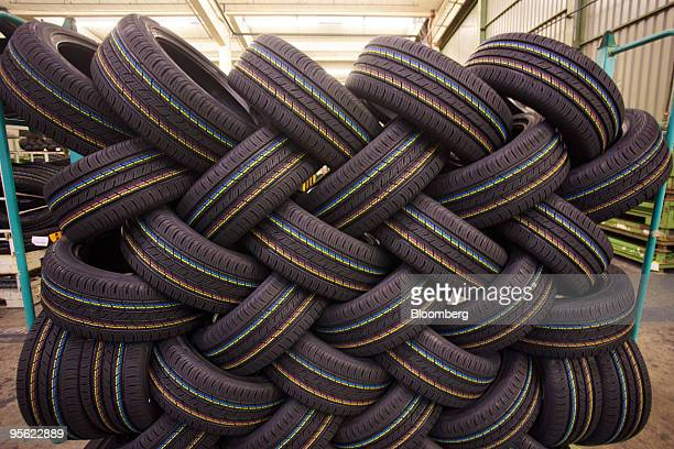 Car tires are seen stacked at the Continental AG factory in Aachen Germany on Wednesday Jan 6 2010 Continental AG Europe's secondlargest autoparts...