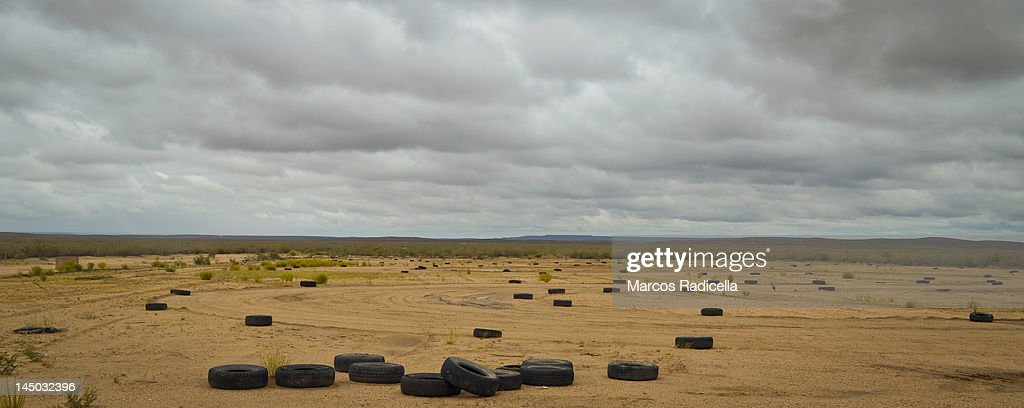 Car tires on landscape : Stock Photo