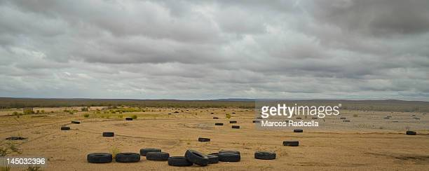 car tires on landscape - radicella stock pictures, royalty-free photos & images