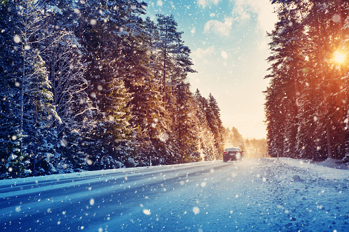 Car tires on winter road 855030442