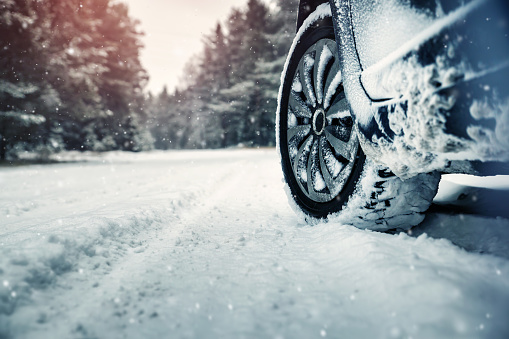 Car tires on winter road 910460770