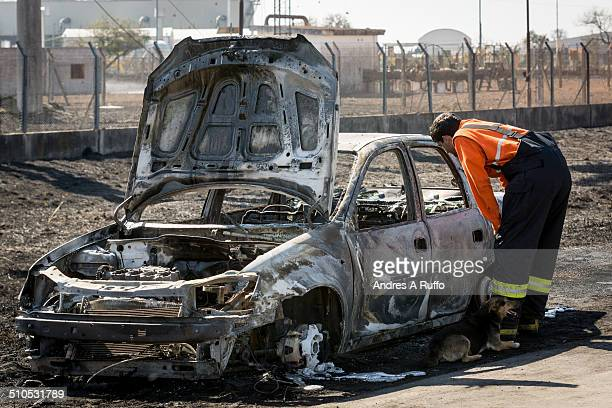 Car to the roadside totally burned and destroyed by the explosion of a gas pipeline from the Central Thermoelectric the town of Pilar province of...