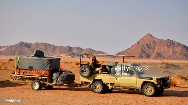 Car tows a folded hot air balloon in the Namib Desert. Sossusvlei area. Sesriem. Namibia.