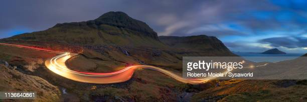 car trails lights, nordradalur, faroe islands - atlantic ocean stock pictures, royalty-free photos & images
