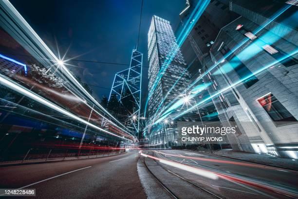 car trails on night street at hong kong central - negócios finanças e indústria imagens e fotografias de stock