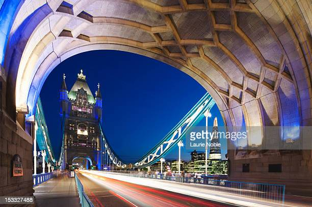Car trails on Tower bridge; London; England