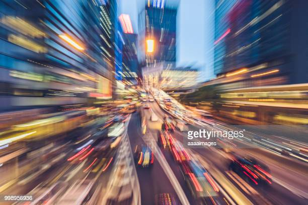 car trails rushing in central hong kong - zoom effect stock pictures, royalty-free photos & images