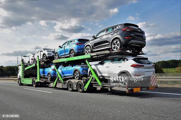 car transporter driving on the highway - automotive stockfoto's en -beelden