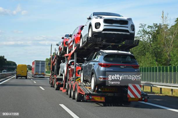 Car transporter driving on the highway