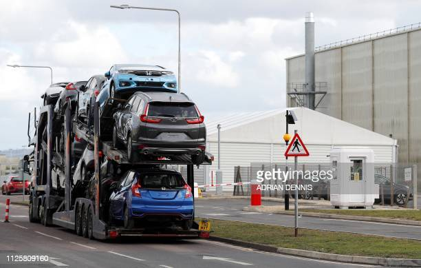 A car transporter loaded with Honda vehicles is driven in to the Honda manufacturing plant in Swindon southwest England on February 19 2019 Honda...