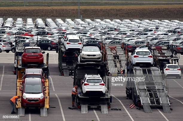 car transporter lorries on the car factory parking - kia stock pictures, royalty-free photos & images