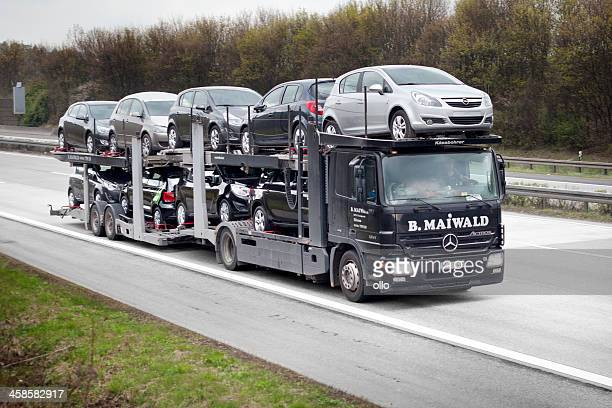 car transporter on german autobahn - car transporter stock photos and pictures