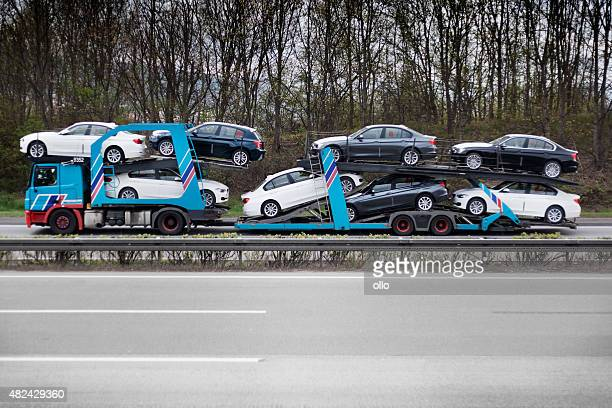 car transporter on german highway - car transporter stock photos and pictures