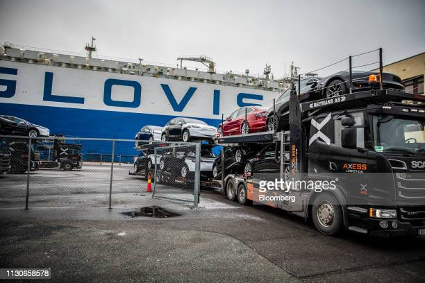 A car transporter truck carries automobiles produced by Tesla Inc from the Port of Oslo after arriving on the Glovis Courage vehicles carrier vessel...