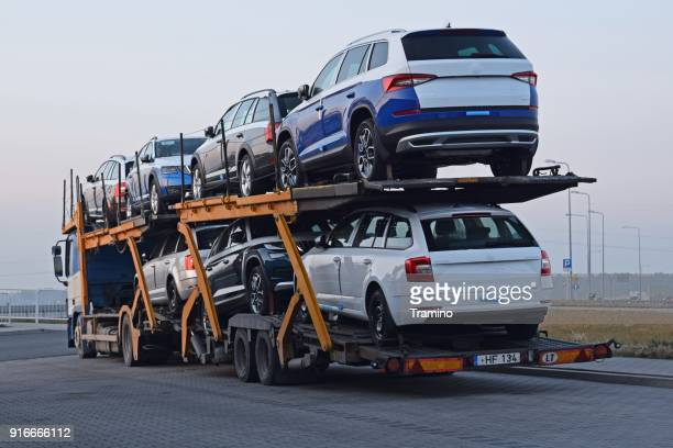 car transporter with skoda vehicles parked on the road - car transporter stock photos and pictures