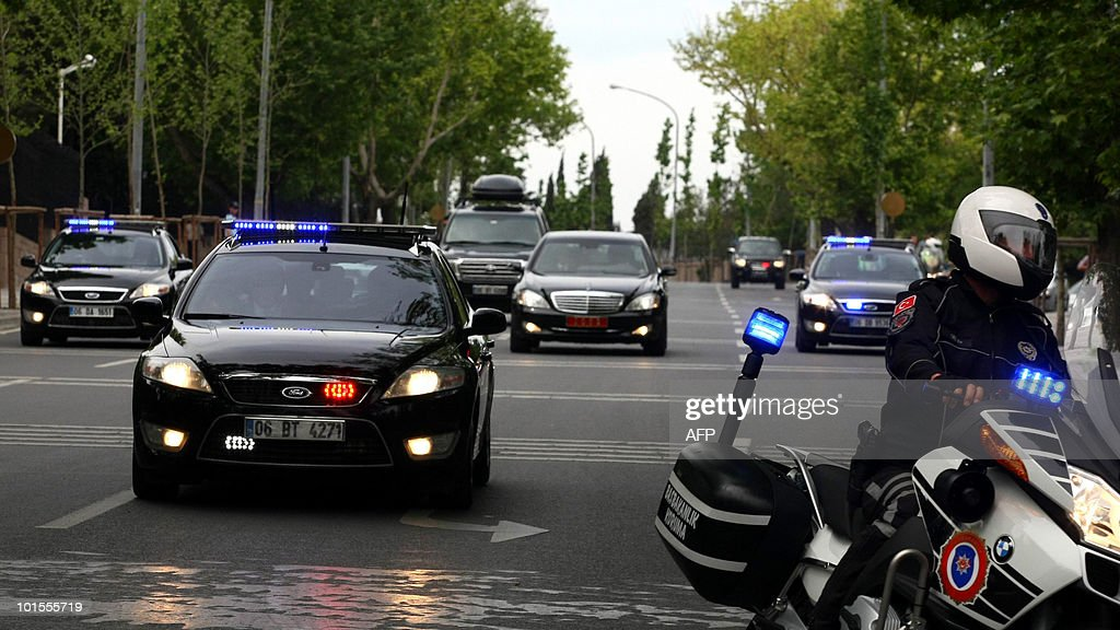 A car (R) transporting Turkish Prime Minister Recep Tayyip Erdogan is escorted by security on June 2, 2010 in Ankara as he heads for a high security meeting with top army commanders and key ministers to discuss the crisis with Israel. Turkey's Justice Ministry is also mulling possible legal action against Israel over its deadly raid early on May 31 on aid ships bound for the Gaza Strip, Anatolia news agency reported on June 2.