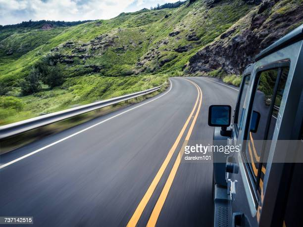 Car traveling along winding road, Maui, Hawaii, America, USA