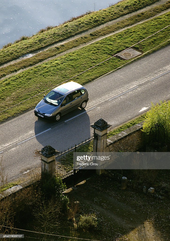 Car traveling on highway, high angle view, blurry. : Stockfoto