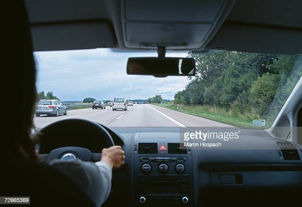 Car traveling on multiple lane highway