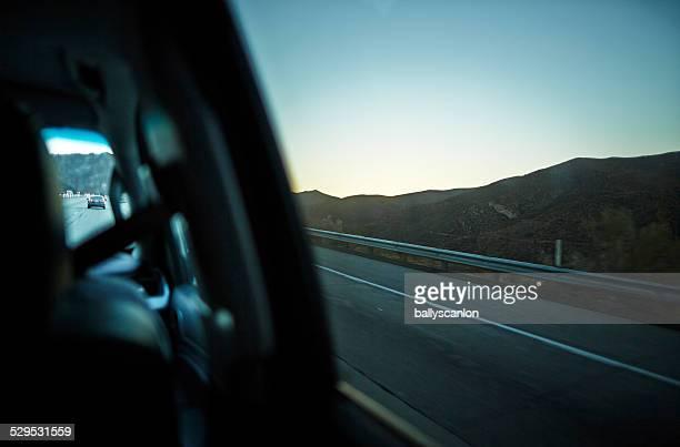 Car traveling through the desert