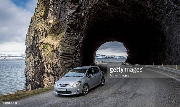 Car travelling through mountain tunnel