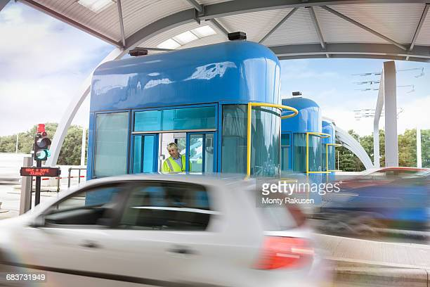 Car travelling through toll booth at bridge