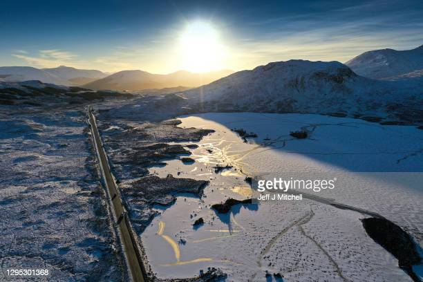 Car travels along the A82 past a frozen Lochan na Achlaise as freezing temperatures continue on January 8, 2021 in Glen Coe, Scotland. The Met Office...