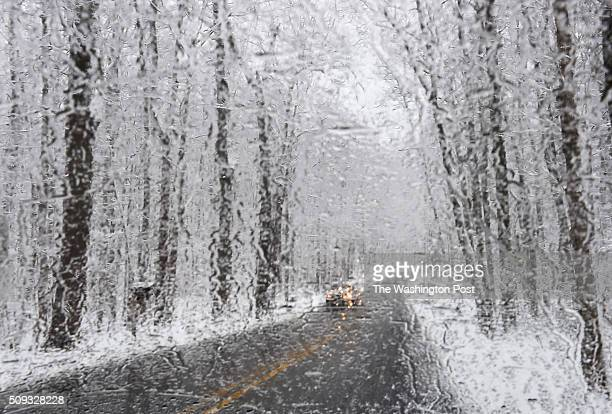 A car travels on Gambrill Park Road during a snowy morning on February 9 2016 in Myersville Md